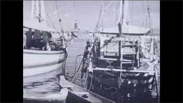 1930s: Boats in water. Intertitle card.