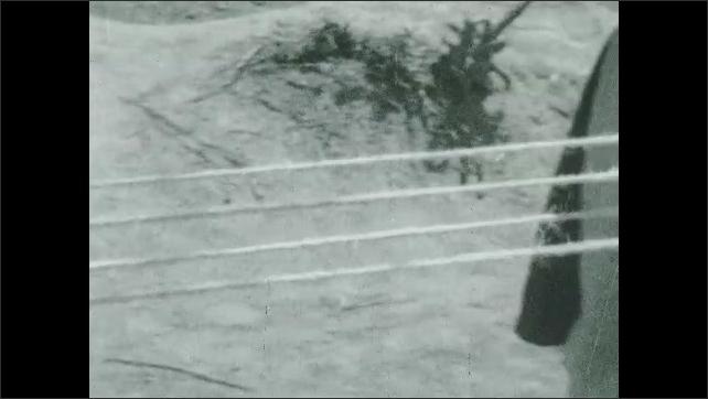 1930s: Hands twisting cords on machine. Pan across cord twisting into rope, hands holding cord.