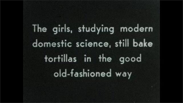 1930s: Girls by machine, girl turns on switch. Intertitle. Girls rolling tortillas on tree stump.