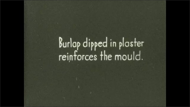 1930s: UNITED STATES: close up of wet plaster running down bust. Burlap dipped in plaster reinforces mould.