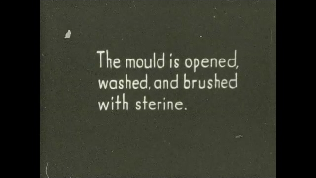 1930s: UNITED STATES: man carves off burlap from mould. Man uses hammer and chisel to break mould. Artist opens mould and washes it before brushing with sterine.