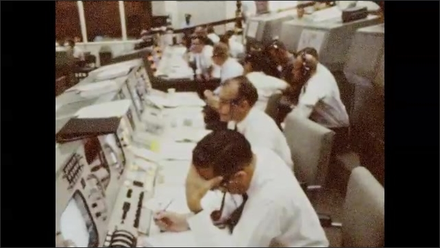 1960s: Side view of man. Men seated at monitors. Close up of Neil Armstrong.