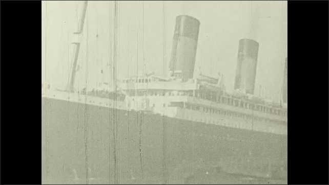 1930s: UNITED STATES: tramp ship leaves Southampton. Passenger liner leaves port. People on deck of cruise liner. Sailing ship at sea