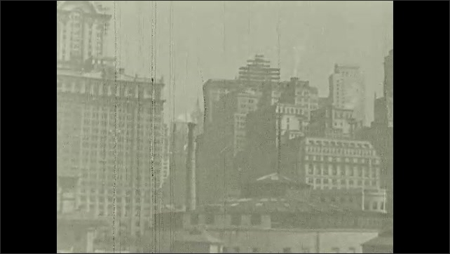 1930s: UNITED STATES: America's largest seaport title. View of New York from water. Buildings in New York.