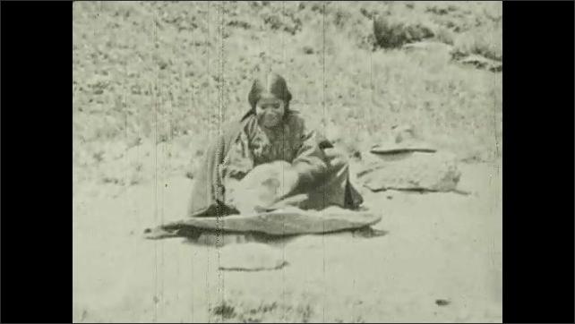 1930s: UNITED STATES: ladies work ground in Molendo, Peru. Man rocks stones in water