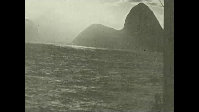 1930s: UNITED STATES: ships in sea port. Clouds and rain over coast of Brazil.