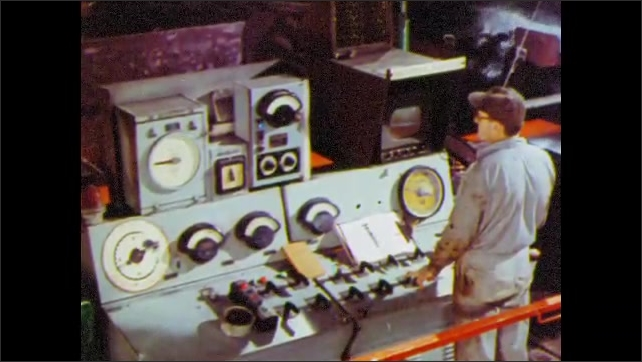 1960s: UNITED STATES: sheet of steel on production line. Man controls dials on machine. Run out table sprays water on steel