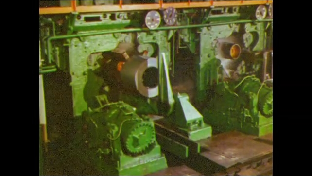 1960s: UNITED STATES: hot rolled steel on machine. Steel processing. Oxide removed from steel. Cold reduced steel