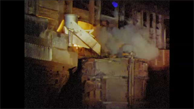 1960s: UNITED STATES: workers leave steel mill. Men leave work. Blast furnace in factory. Flames and smoke in furnace