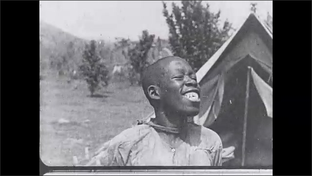1930s: Title. Close up of boy smiling. Intertitle.