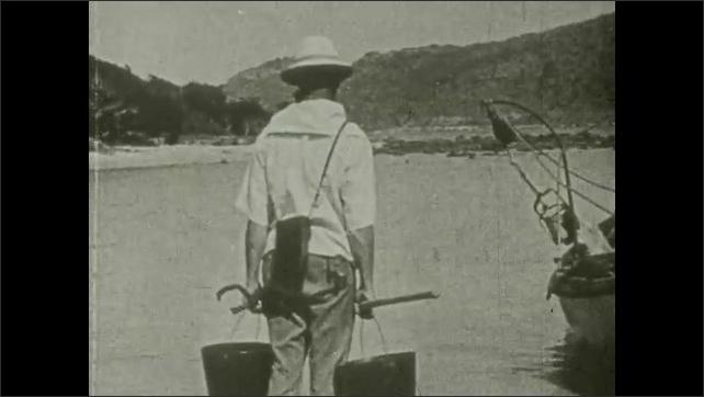 1930s: Title card. Three men stand around row boat near shore. Title card. Three men in row boat in water, man sticks head overboard.