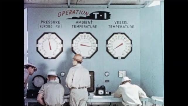 1950s: Men scrape frost from frozen pressure vessel. Men observe large temperature gauges. Workers operate switches. Frozen piston slowly pumps.