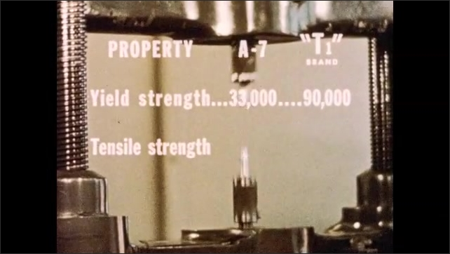 1950s: Steel sample sits in tensile strength testing machine. Text appears on screen. Steel samples snap. Man attaches steel sample to machine.