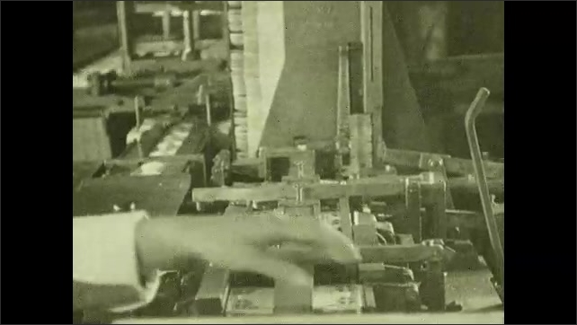 1930s: Hand slides cans of fish into machine. Machine presses fish into can. Hands work on mechanical fish cannery line. Women assemble boxes for fish cans.