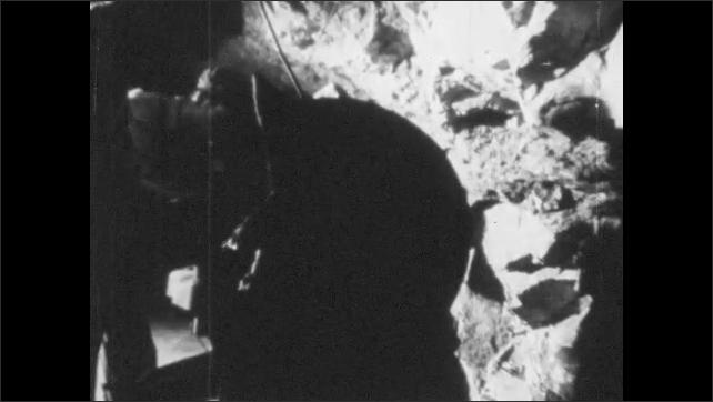 VIETNAM 1960s: Men at work on machines in tunnel.