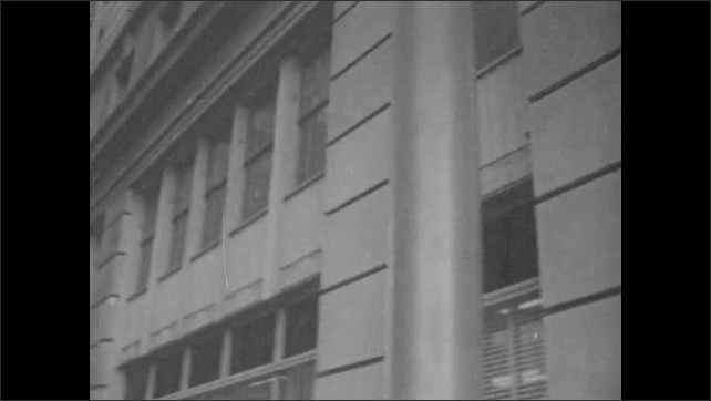 1960s: Directional signs for Dupont building. City street. Mansions. Sign for stock exchange. Man cleans sidewalk.