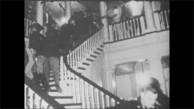 1960s: Police pat down students entering school. Students yell. Police arrest protesters at state capital. Dupont estate.