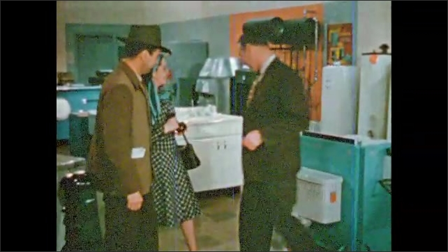 1950s: Man talks to salesman, smiles, laughs, points at salesman. Couple follows salesman to water heaters.