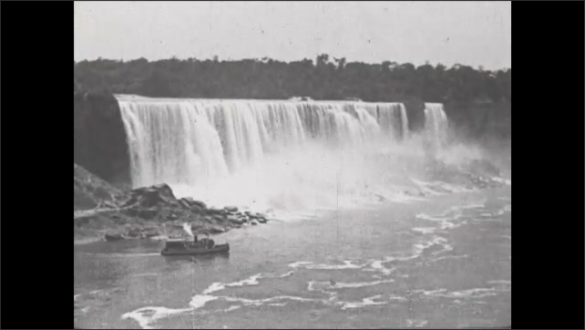 1930s: Title card. People and cars go over Upper Arch Bridge. Steamboat goes by Niagara Falls.