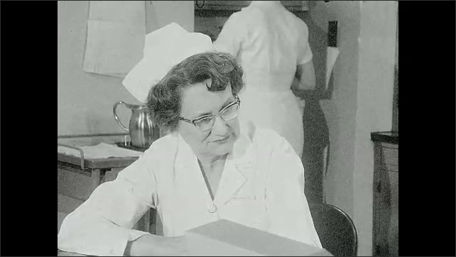 1960s: Nurse listening intently.