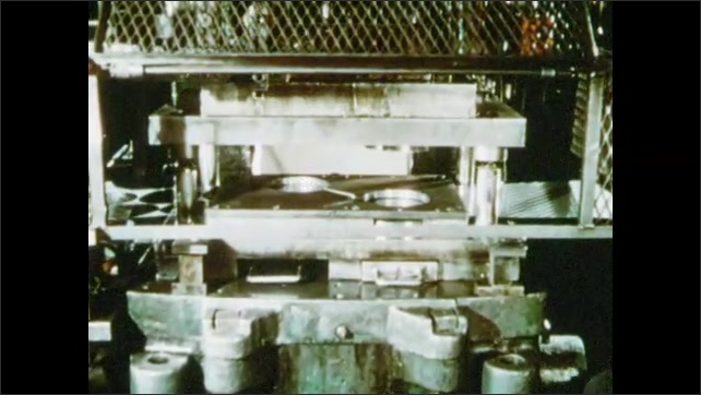 1950s: Sheet of stainless steel runs through press. Press cuts out circles of metal. Machine shapes metal into pot. Man places sheet of metal onto press.