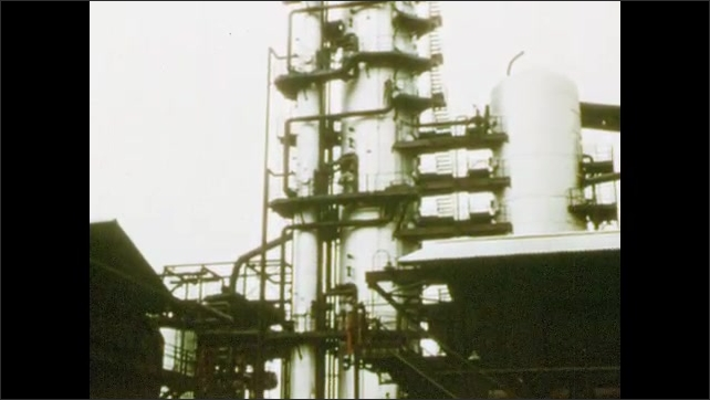 1950s: Exterior of oil refinery.