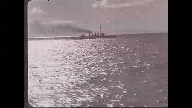 1930s: Philippines: US Navy ship at sea. Ships on Pacific Ocean. Smoke from chimney on ship. Ships approach anchorage.