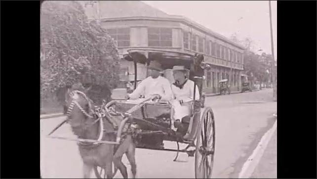 1930s: Philippines:  sailors take ride in carromata. Sailor looks through cart window. Horse pulls cart. Waterfalls in Luzon. Sailors by waterfall.