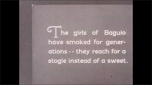 1930s: Philippines:  flappers carry baskets through market streets. Girls of Baguio smoke stogies.