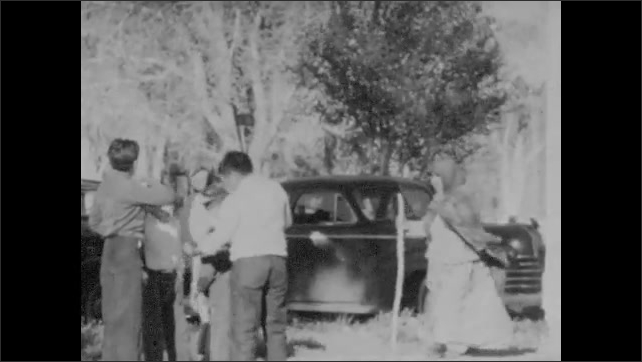 1930s: Church service is over and people leave the church. Intertitle about church at Yerington. Exterior of Yerington church with Indian Mission sign outside.