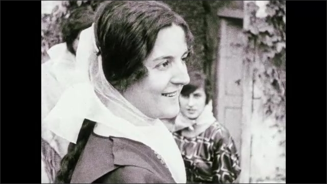 """1930s: Woman smiles.  Caption reads """"As cute as it is curious.""""  Women model scarves.  Caption reads """"Fine roads lead to charming scenes of country life.""""  Trees."""