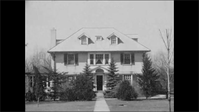 1940s: Nice house with manicured lawn.