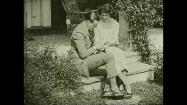 "1930s: Man and woman sit and talk.  Man puts ring on woman's finger.  Caption reads ""The happiest homes result from wise mating, healthy thinking and healthy living."""