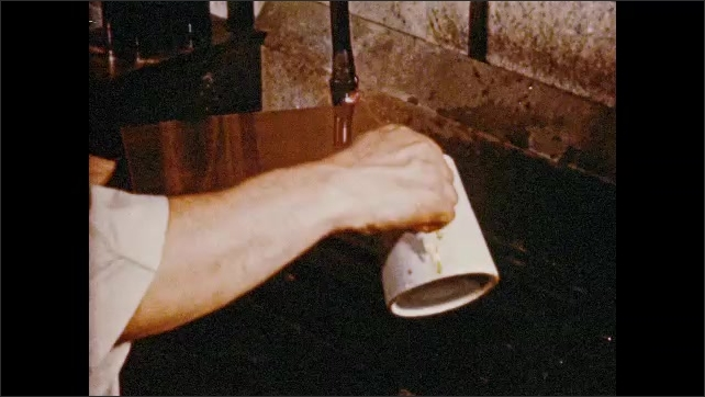 1950s: UNITED STATES: man prints negative on metal. Man covers screen to fix image on metal. Plate inside drier.
