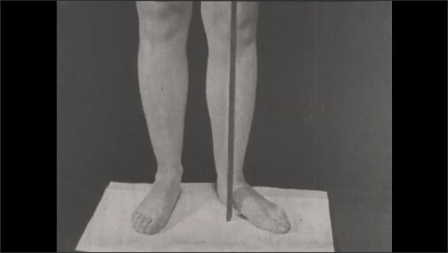 1930s: UNITED STATES: angles on soles of feet. Flat footed person. Centre of gravity through foot