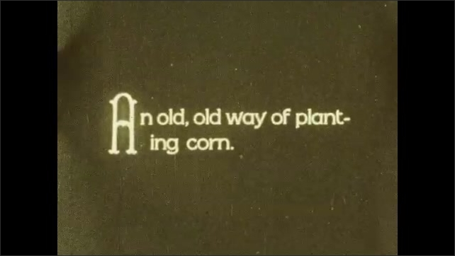 1930s: Farmland in valley. Title card. Person works in field on farm.