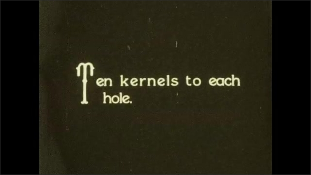 1930s: Man in field on farm uses stick to dig hole for planting seeds. Title card. Man plants seeds in hole.