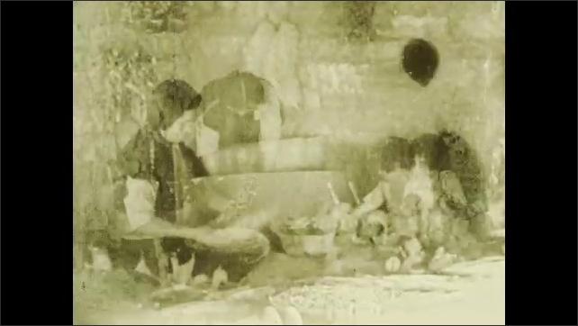 1930s: Woman prepares food while girl plays with dolls. Title card. Woman continues food preparation while girl plays.
