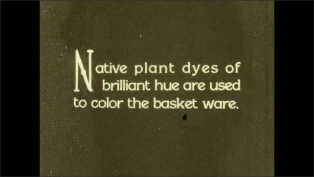1930s: Woman sits weaving basket while woman sits next to her holding baby and a parrot walks through room. Woman weaves basket. Title card. Woman continues weaving. Title card.