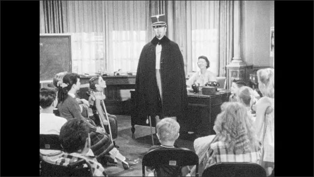 1950s: Man speaks to group of children.  Man changes hats.  Man points sword at kids.  Children laugh.