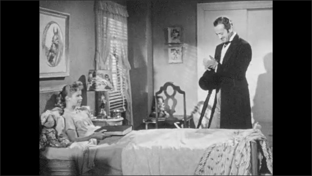 1950s: Nurse and man enter girl's bedroom.  Girl rests in bed.  Man sits down.  Girl opens book.