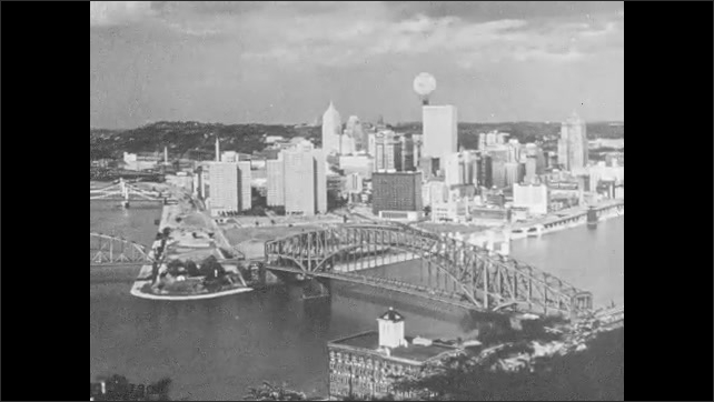 1950s: Hot air balloon flies over city.