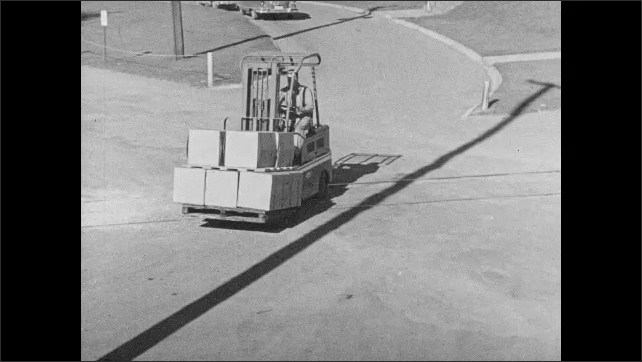 1960s: UNITED STATES: Stop Look and Listen sign. Fork truck drives along track,. Vehicle crosses tracks. Man shakes head. Tyres fall from truck.