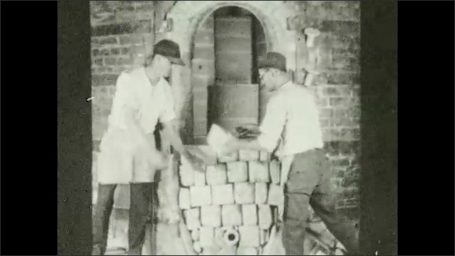 1930s: Clay oven. Two men take out bricks from the entrance of a clay oven. Man carries out a clay pot from the oven.