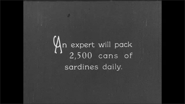 1930s: CANADA: cannery workers pack fish into cans. Sardine packer. Man carries tray of fish.