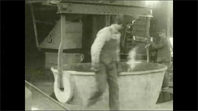 1930s: UNITED STATES: houses in mountains. Workers on mountain. Metal poured into mold