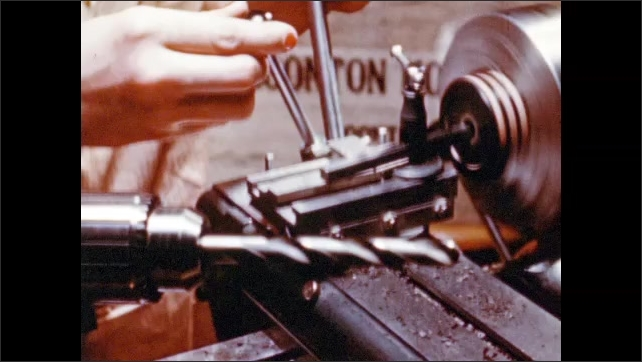 1950s: UNITED STATES: workers finish trims on plastic in workshop. Drill and bore tools. Plastic in plug gage.