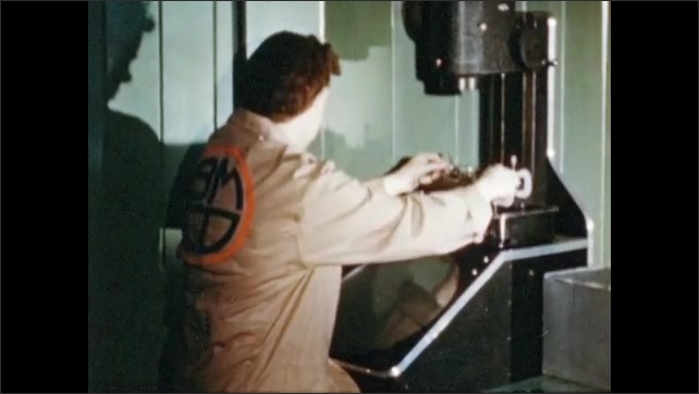 1950s: UNITED STATES: Worker inspects plastic. Plastic in vice. Hands turn handle. Round plastic testing. Rings checked for flatness on shadow graft. Microphone mouthpiece testing