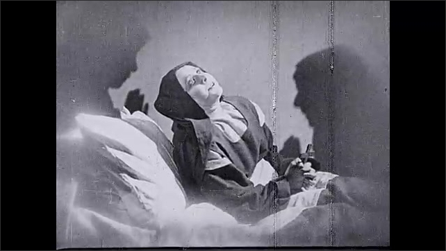 1930s: UNITED STATES: My God, Mio Dio title. Nurse lies in bed. I Love thee title. Nun dies in bed
