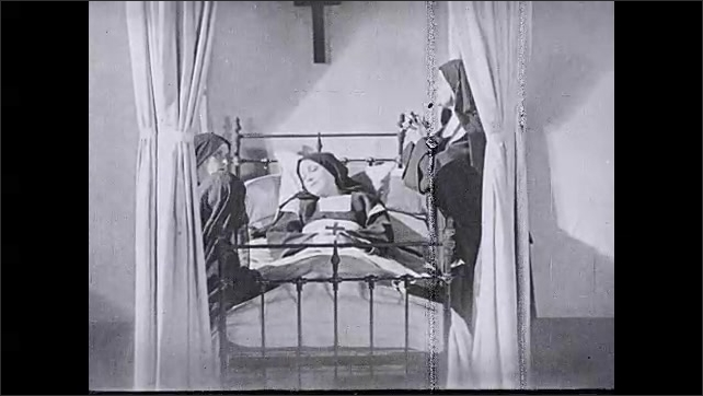 1930s: UNITED STATES: nun lies in bed. Nuns gather around lady in bed. Lady collapses against pillow. Nun places flowers on lady.